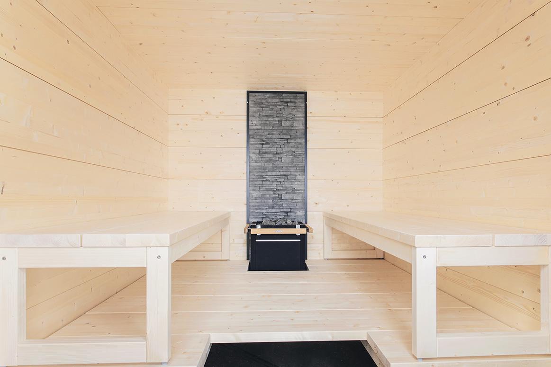 Sauna traditionnel massif intérieur extérieur design